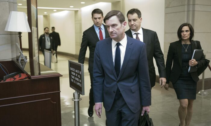 Under Secretary of State for Political Affairs David Hale (C) departs the U.S. Capitol after giving a closed-door deposition to the House committees conducting the impeachment inquiry of President Donald Trump in Washington on Nov. 6, 2019. (Chip Somodevilla/Getty Images)