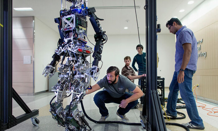 Mechanical engineering students prepare for the Defense Advanced Research Projects Agency Robotics Challenge at Virginia Tech on April 9, 2015. (Chip Somodevilla/Getty Images)