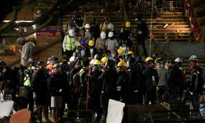 Hong Kong universities have been closing their campuses as violent protests take over. (The Canadian Press)