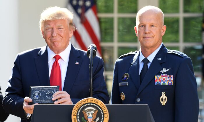 General John W. Raymond (R) and President Donald Trump pose during an event establishing the US Space Command in the Rose Garden of the White House in Washington, on Aug. 29, 2019. (Saul Loeb/AFP via Getty Images)