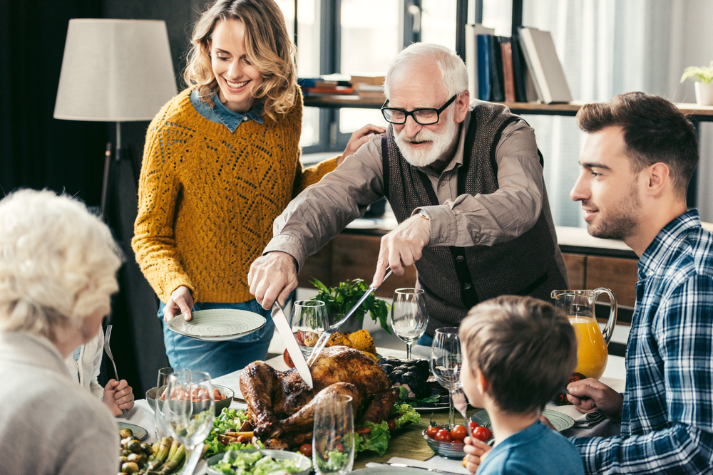 grandfather cutting turkey