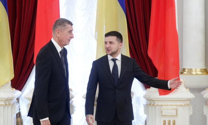 Ukrainian President Volodymyr Zelensky shows the way to Czech Prime Minister Andrej Babis during a meeting in Kiev on Nov. 19, 2019. (Valentyn Ogirenko/Reuters)