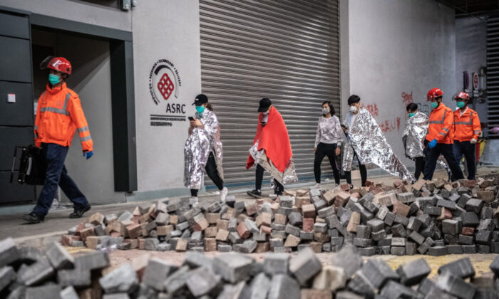 Medics lead away protesters at Hong Kong Polytechnic University on Nov. 20, 2019. (Laurel Chor/Getty Images)