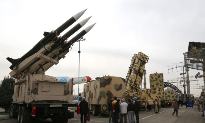 Iranians visit a weaponry and military equipment exhibition in the capital Tehran on Feb. 2, 2019. (Atta Kenare/AFP via Getty Images)