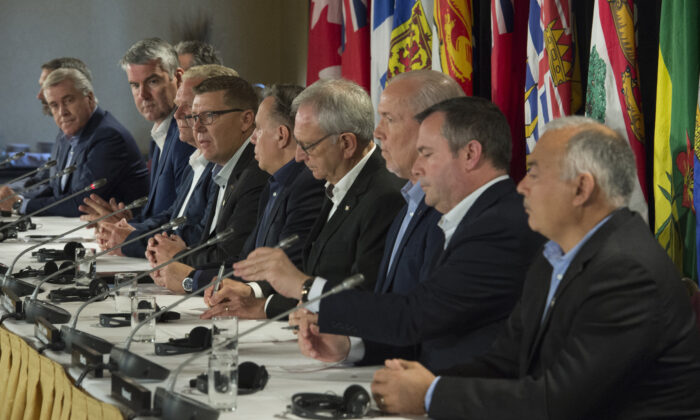 Canada's provincial premiers attend a news conference following a meeting in Saskatoon, Sask., on July 11, 2019. (The Canadian Press/Jonathan Hayward)
