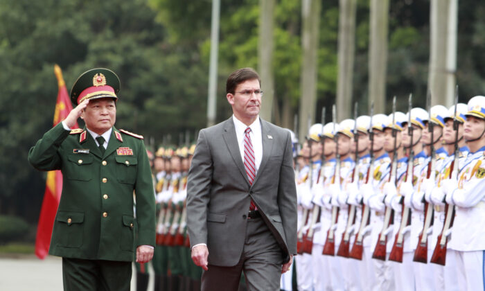 U.S. Defense Secretary Mark Esper (R) and Vietnamese Defense Minister Ngo Xuan Lich review an honor guard in Hanoi, Vietnam on Nov. 20, 2019. Esper is on a visit to Vietnam to strengthen the military relations with the Southeast Asian nation. (Hau Dinh/AP)