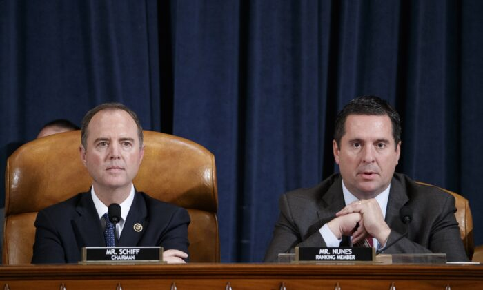House Intelligence Chairman Adam Schiff (D-Calif.) listens as Ranking Member Rep. Devin Nunes (R-Calif.) speaks at the open impeachment hearing in Washington on Nov. 19, 2019. (Shawn Thew - Pool/Getty Images)