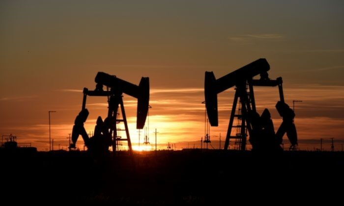 Pump jacks operate at sunset in an oilfield in Midland, Texas, on Aug. 22, 2018. (Reuters/Nick Oxford)