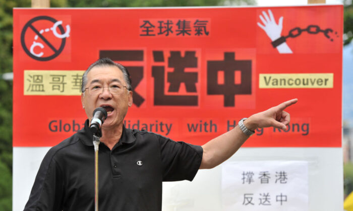 Rally organizer Kenneth Tung addresses demonstrators gathered in front of the Chinese Consulate in Vancouver  in support of pro-democracy protesters in Hong Kong on June 9, 2019.  (Don MacKinnon/AFP via Getty Image)