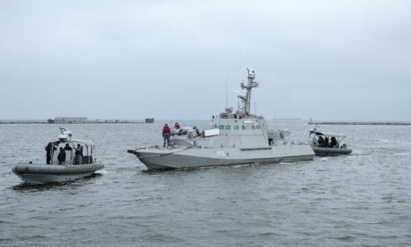 Ukrainian servicemen tug the vessel Nikopol, one of three Ukraine's naval ships captured in the Kerch Strait in November 2018 and then returned by Russia, in the port of Ochakiv, Ukraine November 20, 2019. (Oleg Novikov/Reuters)