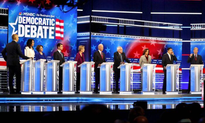 Democratic presidential candidates from left, Sen. Cory Booker (D-N.J.), Rep. Tulsi Gabbard (D-Hawaii), Sen. Amy Klobuchar (D-Minn.). South Bend Mayor Pete Buttigieg, Sen. Elizabeth Warren (D-Mass.), former Vice President Joe Biden, Sen. Bernie Sanders (I-Vt.), Sen. Kamala Harris (D-Calif.), former technology executive Andrew Yang and investor Tom Steyer participate in a Democratic presidential primary debate, in Atlanta, Ga., on Nov. 20, 2019. (John Bazemore/AP Photo)