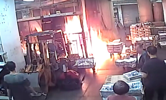 Surveillance footage of the arson attack at the printing press for the Hong Kong edition of the Epoch Times on Nov. 19.
