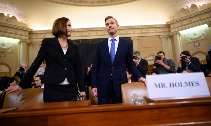 Fiona Hill, the former top Russia expert on the National Security Council, and David Holmes, a State Department official stationed at the US Embassy in Ukraine arrive to testify during the House Intelligence Committee hearing as part of the impeachment inquiry into President Donald Trump on November 21, 2019,  on Capitol Hill in Washington. (Jim Watson/AFP via Getty Images)