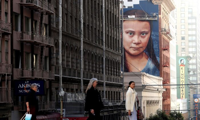 A new four-story-high mural of 16-year-old Swedish climate activist Greta Thunberg is nearing completion on the side of a building near Union Square in San Francisco, California, Nov. 11, 2019. (Justin Sullivan/Getty Images)