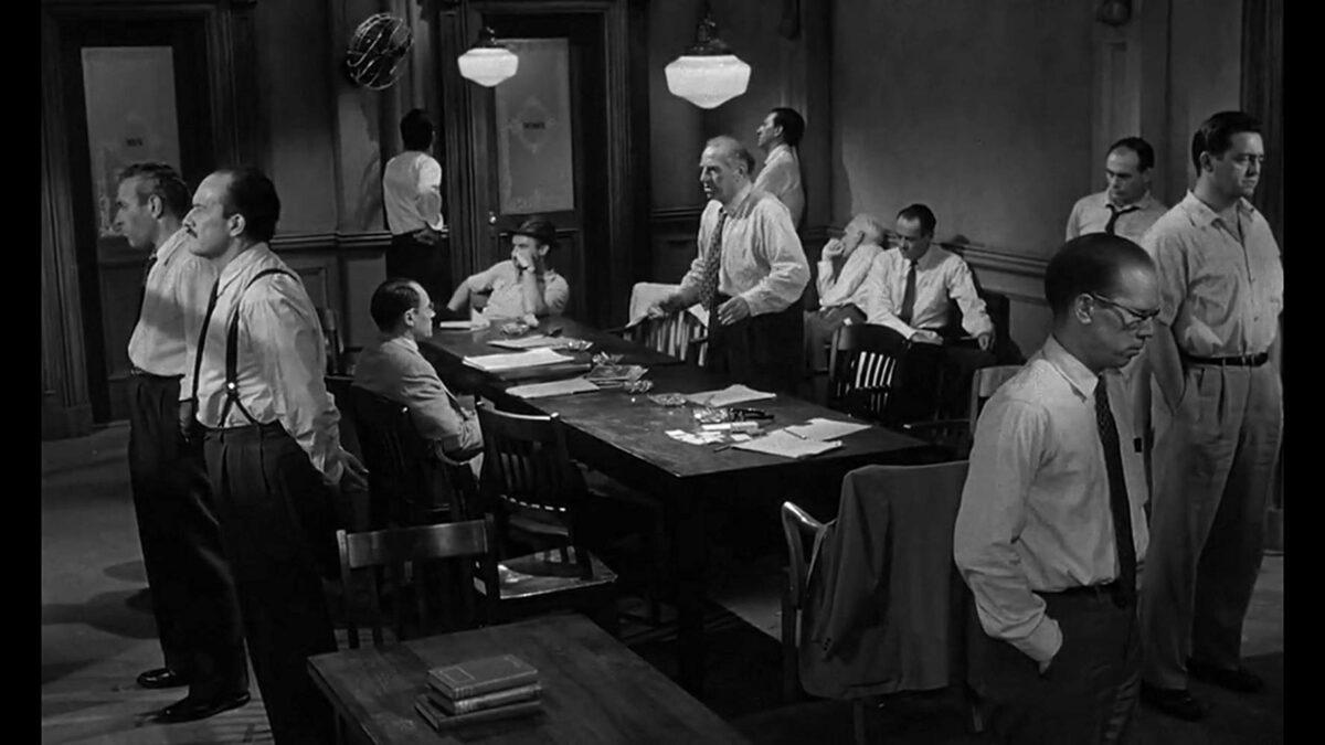 12 jurors stand around table