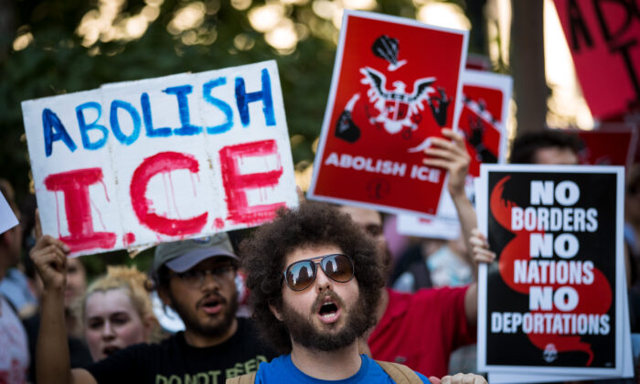 Activists march and rally against Immigration and Customs Enforcement (ICE) and the Trump administration's immigration policies, outside of the ICE offices in Federal Plaza, June 29, 2018 in New York City.  (Photo by Drew Angerer/Getty Images)