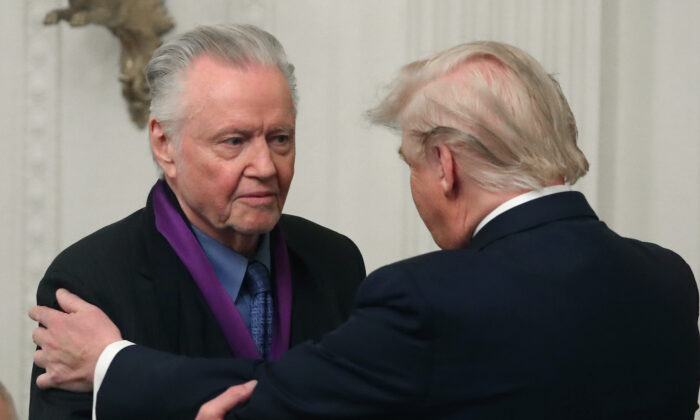 President Donald Trump (R) presents actor Jon Voight with the National Medal of Arts during a ceremony in the East Room of the White House in Washington on Nov. 21, 2019. (Mark Wilson/Getty Images)