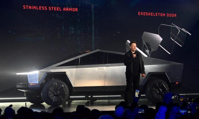 Tesla CEO Elon Musk unveils the Cybertruck at the TeslaDesign Studio in Hawthorne, Calif., on Nov 21, 2019. (Robert Hanashiro-USA TODAY)
