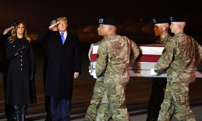 First Lady Melania Trump and President Donald Trump watch as the remains of Chief Warrant Officer 2 David C. Knadle are carried during a dignified transfer at  Dover Air Force Base in Dover, Del., on Nov. 21, 2019. (Mandel Ngan/AFP via Getty Images)