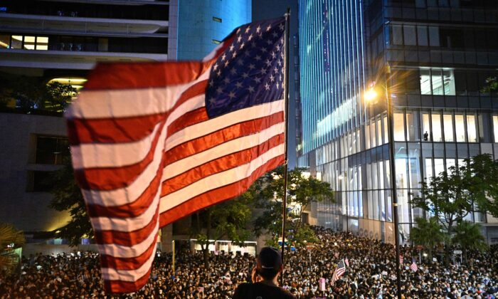 A man waves a US national flag as protesters attend a rally in Hong Kong on Oct. 14, 2019. (Anthony Wallace/AFP via Getty Images)