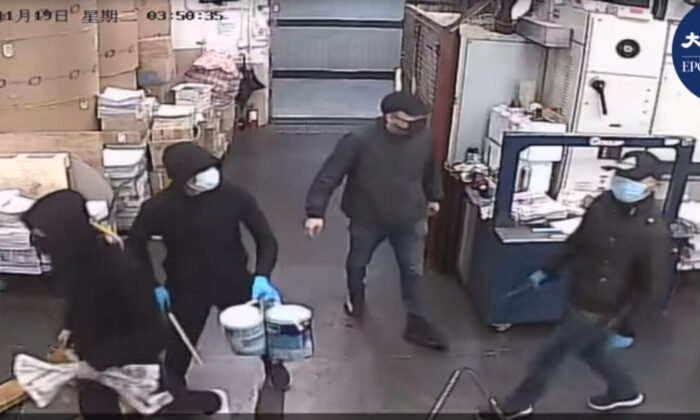 Surveillance footage showing four masked men entering the Hong Kong Epoch Times print shop before threatening workers and setting a fire on Nov. 19, 2019. (The Epoch Times)