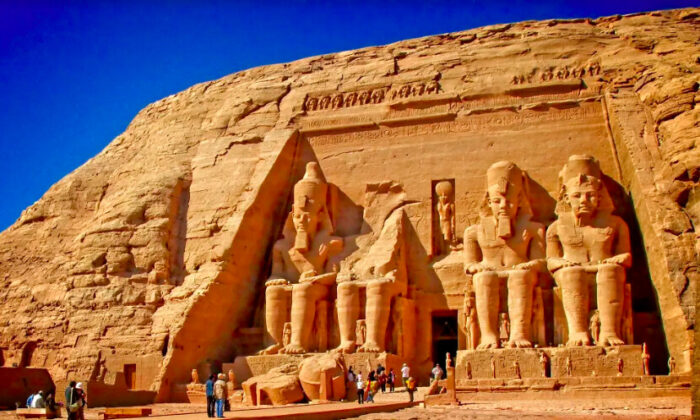 At the Great Temple of Abu Simbel, also known as the Temple of Ramses, four gigantic figures of Egypt's longest reigning Pharaoh tower 66 feet high and are set against a 108-foot-high façade recessed into the side of a cliff. (Fred J. Eckert)