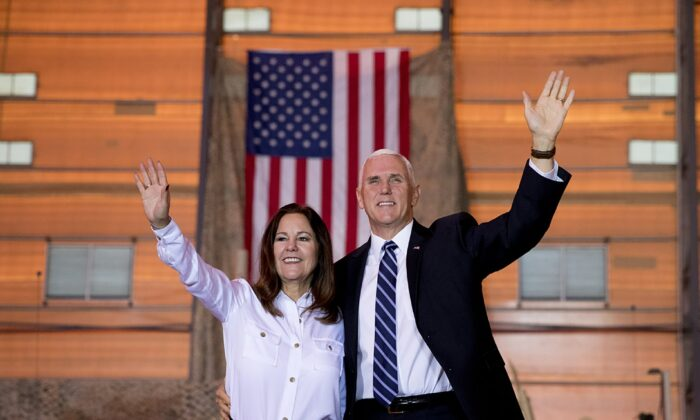 Vice President Mike Pence and his wife Karen Pence wave as they take the stage to speak to troops at Al Asad Air Base, Iraq on Nov. 23, 2019. (Andrew Harnikf/AP Photo)