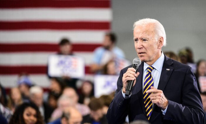 Democratic presidential candidate former vice President Joe Biden speaks to the audience during a town hall in Greenwood, South Carolina on Nov. 21, 2019. (Photo by Sean Rayford/Getty Images)
