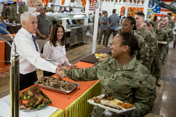 Vice President Mike Pence and his wife Karen Pence, second from left, serve turkey to troops at Al Asad Air Base, Iraq on Nov. 23, 2019. (AP Photo/Andrew Harnik)