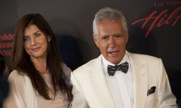 Actor Alex Trebek (R) and wife Jean Currivan Trebek arrive at the 38th Annual Daytime Emmy Awards show in Las Vegas, Nev., on June 19, 2011. (Adrian Sanchez-Gonzalez/AFP via Getty Images)