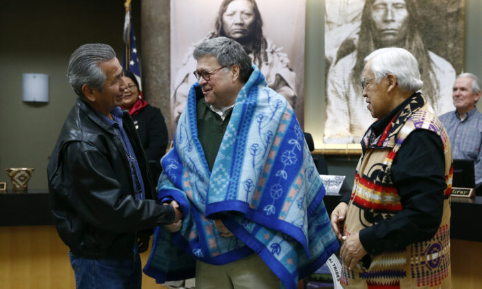 Attorney General William Barr (C) shakes hands with Vernon Finley (L) and Tony Incashola (R) at the Flathead Reservation in Pablo, Mont., on Nov. 22, 2019, (Patrick Semansky/AP)