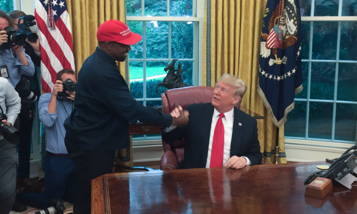 President Donald Trump meets with rapper Kanye West in the Oval Office of the White House in Washington on Oct. 11, 2018. (SEBASTIAN SMITH/AFP via Getty Images)