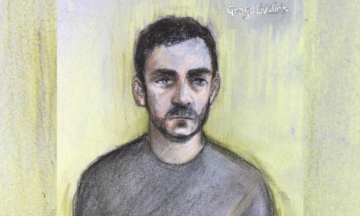 A court artist sketch by Elizabeth Cook, shows lorry driver Maurice Robinson on a video-link at Chelmsford Magistrates' Court, England on Oct. 28, 2019. (Elizabeth Cook/PA via AP)