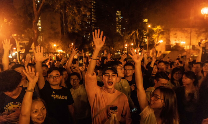 Local residents celebrate as Junius Ho Kwan-yiu loses in District Council Elections, outside a polling station in Hong Kong, on Nov. 25, 2019. (Billy H.C. Kwok/Getty Images)