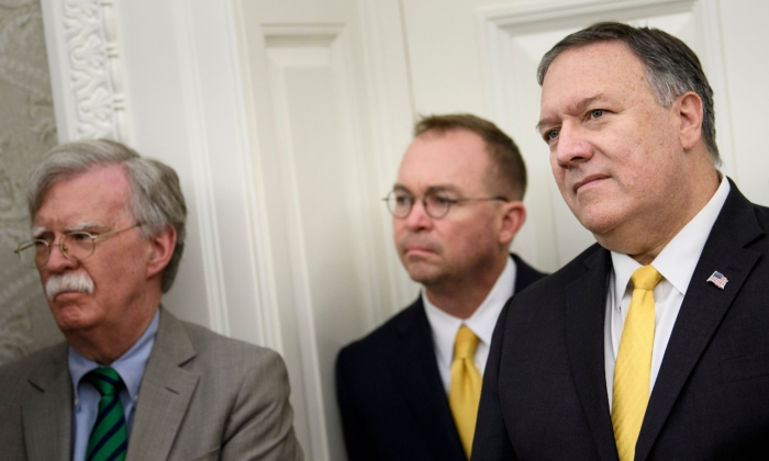 National Security Advisor John R. Bolton (L), acting White House Chief of Staff Mick Mulvaney (C), and Secretary of State Mike Pompeo listen while President Donald Trump announces an agreement with Guatemala in the Oval Office of the White House in Washington on July 26, 2019. (Brendan Smialowski/AFP via Getty Images)