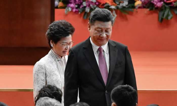 Carrie Lam, Hong Kong's Chief Executive and Chinese leader Xi Jinping attend an inauguration ceremony in Hong Kong, China on July 1, 2017. (Keith Tsuji/Getty Images)