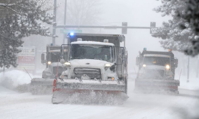 City of Denver snowplows clear the eastbound lanes of Speer Blvd. as a storm packing snow and high winds sweeps in over the region in Denver, Colo., on Nov. 26, 2019. (David Zalubowski/AP Photo)