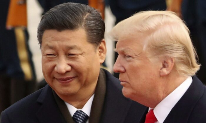 President Donald Trump and Chinese leader Xi Jinping participate in a welcome ceremony at the Great Hall of the People in Beijing on Nov. 9, 2017. (Andrew Harnik/AP Photo)