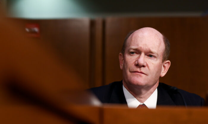 Sen. Chris Coons (D-Del.) listens as Judge Brett M. Kavanaugh testifies before the Senate Judiciary Committee during the third day of his confirmation hearing to serve as Associate Justice on the U.S. Supreme Court at the Capitol in Washington on Sept. 6, 2018. (Samira Bouaou/The Epoch Times)