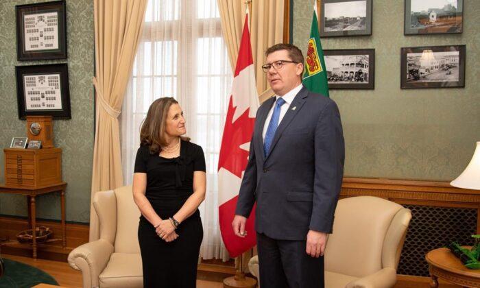 Deputy Prime Minister Chrystia Freeland meets with Saskatchewan Premier ScottMoeat the legislative building in Regina on Nov. 26, 2019. (The Canadian Press/Shawn Fulton)