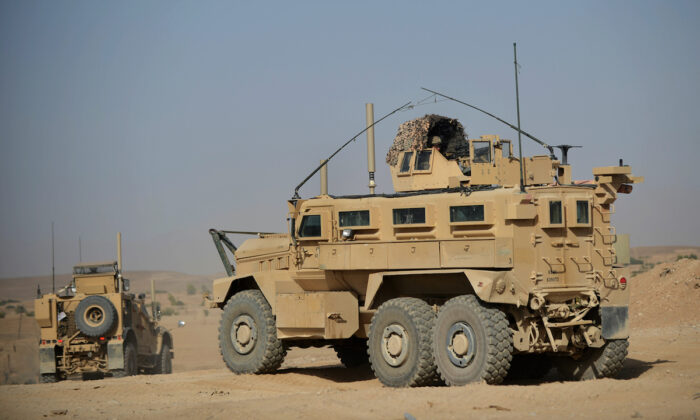 MRAP (Mine Resistant Ambush Protected) vehicles operated by U.S. Marines. (Adek Berry /AFP/GettyImages)