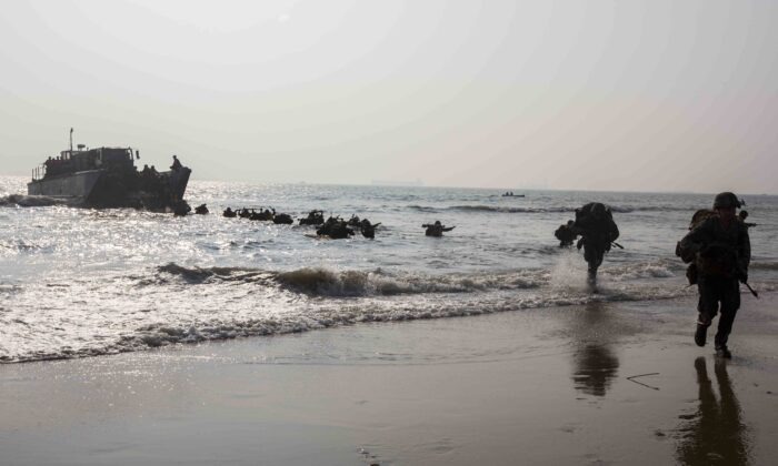 U.S. Marines currently under 4th Marine Regiment, 3rd Marine Division, and members of the Indian military run to shore on Kakinada Beach, India, on Nov. 19, 2019. (U.S. Marine Corps photo by Lance Cpl. Christian Ayers)
