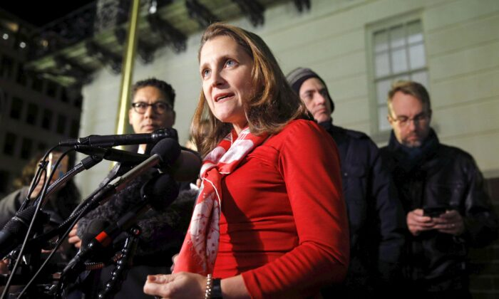 Deputy Prime Minister Chrystia Freeland speaks with members of the press after a meeting at the U.S. Trade Representative's office for talks on the U.S.-Mexico-Canada trade agreement in Washington on Nov. 27, 2019. (AP Photo/Patrick Semansky)