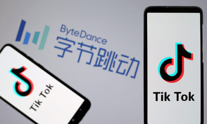 Tik Tok logos are seen on smartphones in front of a displayed ByteDance logo in this illustration taken on Nov. 27, 2019. (Dado Ruvic/Reuters)