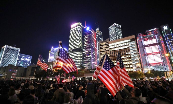 Protesters wave U.S. flags as they attend a gathering at the Edinburgh place in Hong Kong on Nov. 28, 2019. (Vincent Thian/AP Photo)