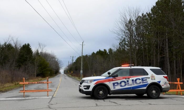 """A police car blocks the end of Creekford Road inKingston, Ontario, Canada, on Nov. 28, 2019. Police inKingston say there are """"numerous fatalities"""" after a small plane crashed in a wooded area within the city limits. (The Canadian Press/Sean Kilpatrick)"""