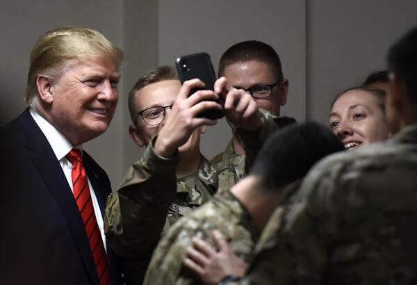 Trump poses for selfies with troops in Afghan