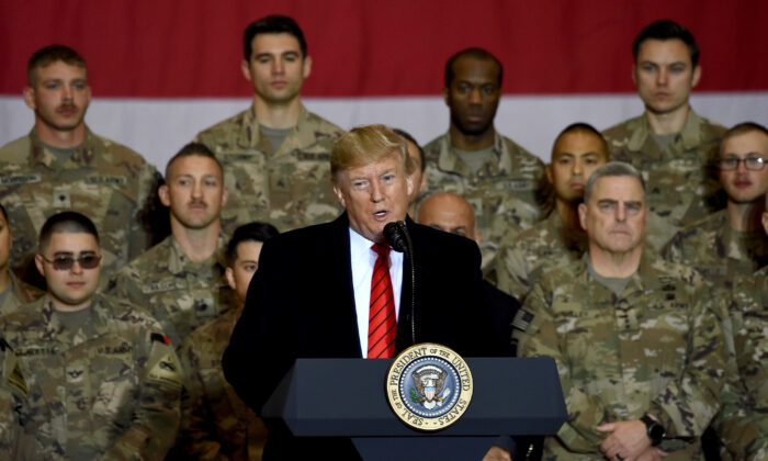 President Donald Trump speaks to the troops during a surprise Thanksgiving day visit at Bagram Air Field, in Afghanistan on Nov. 28, 2019. (Olivier Douliery/AFP via Getty Images)