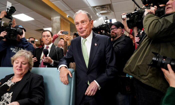 Former New York Mayor Michael Bloomberg arrives to speak with Virginia House Delegate-elect Nancy Guy after launching his presidential campaign in the D'Egg cafe in Norfolk, Virginia on Nov. 25, 2019. (Joshua Roberts/Reuters)