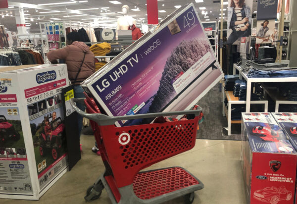 A shopping cart is filled with a television
